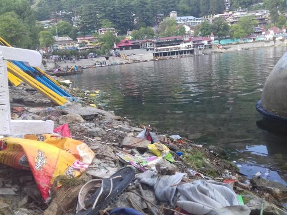 Plastic and other solid waste piled along Naini Lake shore.